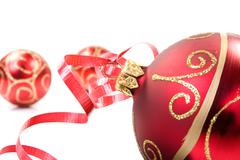 Stock Photo of red baubles over white