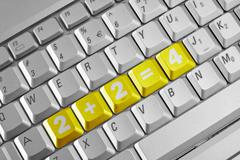 Simple sum on the computer keyboard Stock Photos