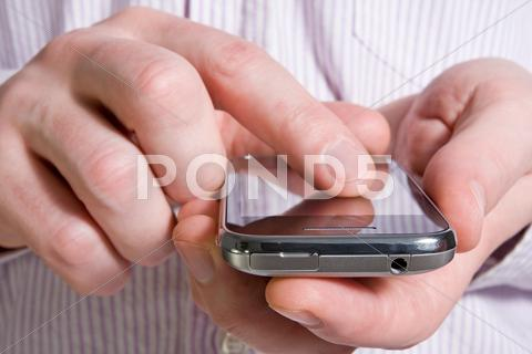 Stock photo of using a smart phone