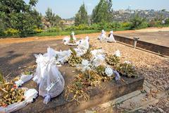 Wilting flowers on top of mass graves at the Rwandan Genocide Memorial. Stock Photos