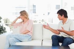 Man pleading with the woman who is turned away not interested Stock Photos