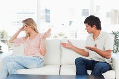 Man trying to apologise but the woman is not interested in it Stock Photos