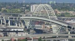 Freemont Bridge in Downtown Portland Oregon across Willamette River Stock Footage