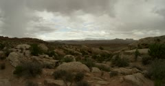 Storm clouds rolling over a desert valley in 4K timelapse Stock Footage