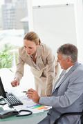 Company people having a conversation about statistic - stock photo