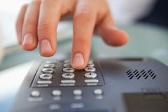 Close-up of a man dialing a telephone number Stock Photos