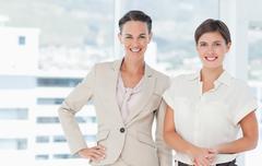 Stock Photo of Smiling businesswomen standing