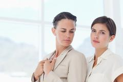 Confident businesswomen standing together - stock photo