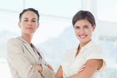 Stock Photo of Confident businesswomen with arms crossed