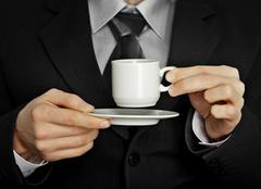 Pause in the work - cup of strong black coffee Stock Photos