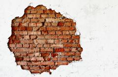 Stock Photo of break on the white wall - old brickwork