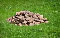 Pile of stones on field Stock Photos