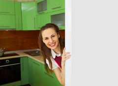Young woman on kitchen near refrigerator Stock Photos
