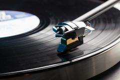 vinyl analog record player cartridge and lp - stock photo