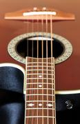 view down the fretboard of guitar - stock photo