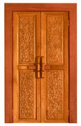 old wooden door with carvings - stock photo