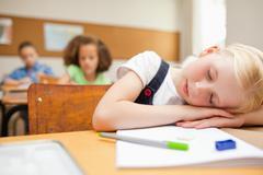 Student felt asleep during class - stock photo