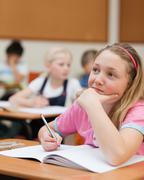 Elementary schoolgirl in thoughts - stock photo