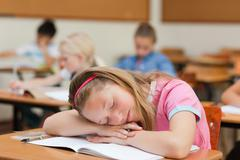 Elementary school student asleep - stock photo