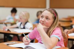 Elementary student in thoughts - stock photo
