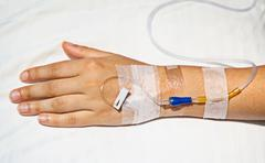 Medical intravenous cannula on hand Stock Photos