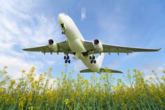 aircraft takes off over the meadow - stock photo