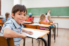 Stock Photo of Boy turned around in class