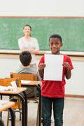 Stock Photo of Student showing his report card