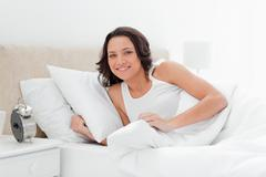 Cute woman wakes up - stock photo
