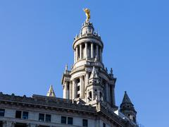 detail of statue on manhattan municipal building - stock photo