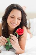 Beautiful woman holding a rose Stock Photos