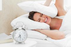 Woman must wake up Stock Photos
