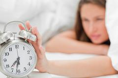 Alarm clock is turned off - stock photo