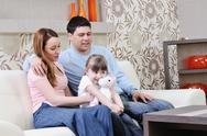 Stock Photo of happy young family at home