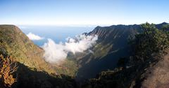 fog forms on kalalau valley kauai - stock photo