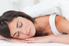 Brunette having a nap Stock Photos