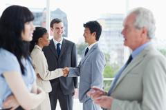 Business people shaking hands after talking to each other - stock photo