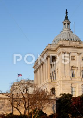 Stock photo of flag flies in front of capitol in dc