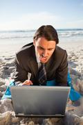 Young businessman typing on his laptop - stock photo