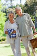 Couple going to have a picnic in the park Stock Photos
