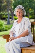 Old woman is sitting down thinking Stock Photos