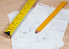 Carpenter pencil and rule on plans Stock Photos