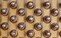 piano strings in macro - stock photo