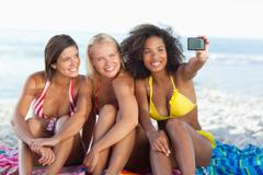 Three friends happily posing for a photo Stock Photos