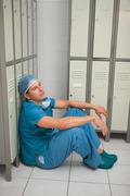 Surgeon sitting in a locker room Stock Photos