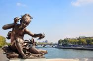 Small child statue frames view of seine and paris Stock Photos
