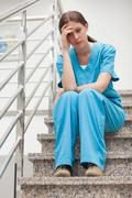 Thinking woman sitting on stairs Stock Photos