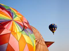 Hot air balloon in the air above two others Stock Photos