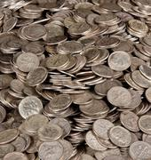 pile of silver dime coins - stock photo