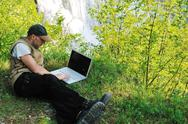 Stock Photo of man outdoor laptop
